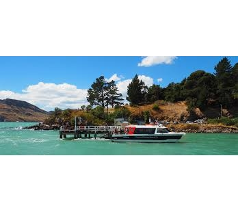 Black cat ferry in front of the diamond Harbour Pier in lyttelton Harbour