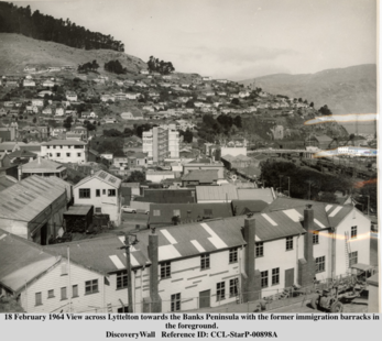 1964 View across Lyttelton towards the Banks Peninsula with the former immigration barracks in the foreground.