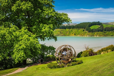 spherical sculpture at Ohinetahi garden looking out into Lyttelton harbour