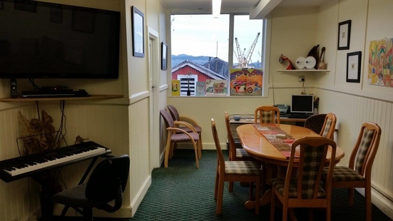 dining table, tv and keyboard at community house Lyttelton