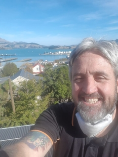 image of duane at harbourside fire with the Lyttelton port behind him.