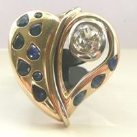gold heart inlaid with gems from julian harding